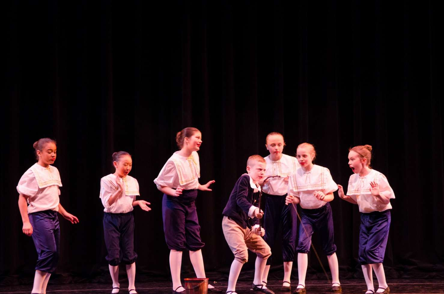 The Sailor School children watch Andrew fishing.